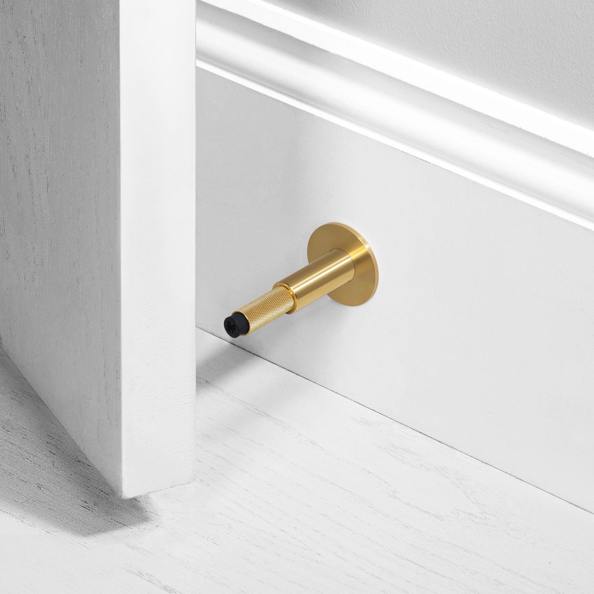 DOOR STOP / WALL / BRASS