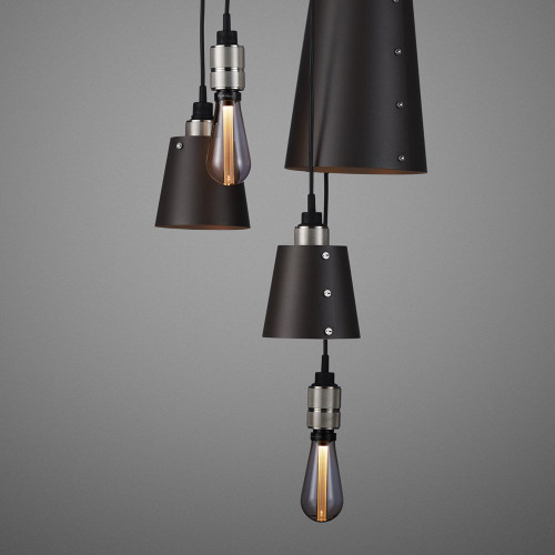 Buster + Punch / Chandelier with six light pendants in solid metal / large and small lamp shades / dark graphite grey and stainless steel