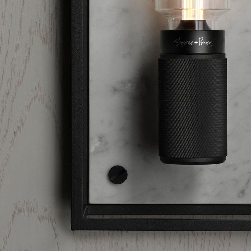 Caged wall light in matt black and polished white marble