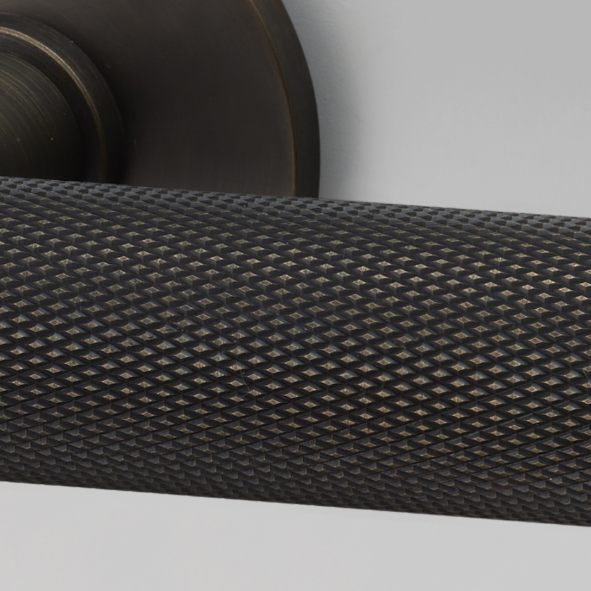 Solid metal DOOR LEVER HANDLE in smoked bronze with signature knurling