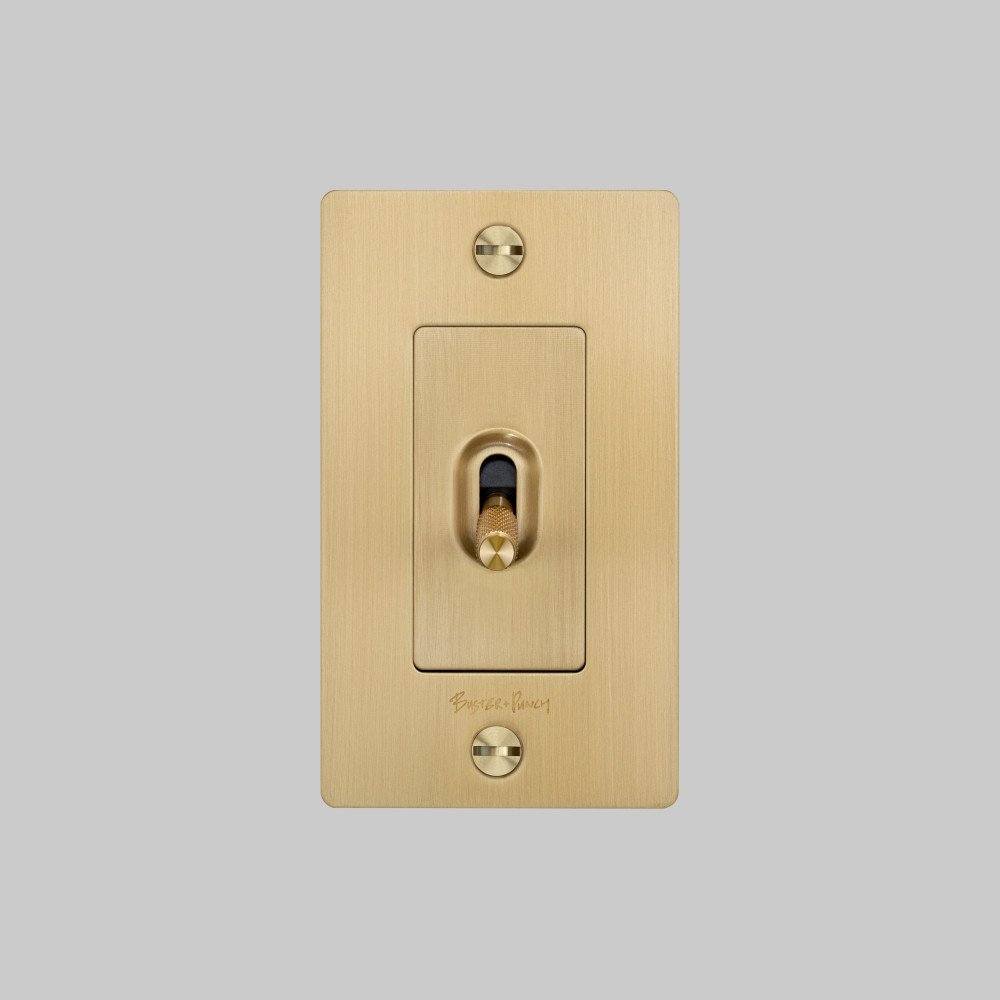 2._buster_punch_us_1g_toggle_brass_front